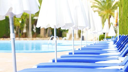 Vacationers can now reserve poolside loungers - for a fee